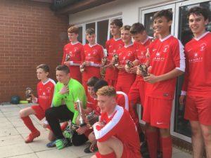 Bournemouth Poppies U15s celebrate winning the Alan Paull Trophy